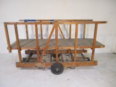 An industrial wooden trolley with platform