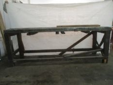 A large industrial workbench with metal covered top. Length 231cm Width 76cm Height 84cm.