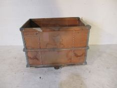 An industrial storage trolley with wooden edging - length 94cm, width 64cm