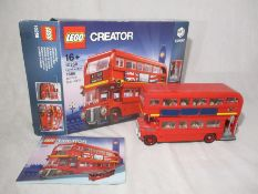A completed Lego Creator (10258) London Bus with original box and instructions