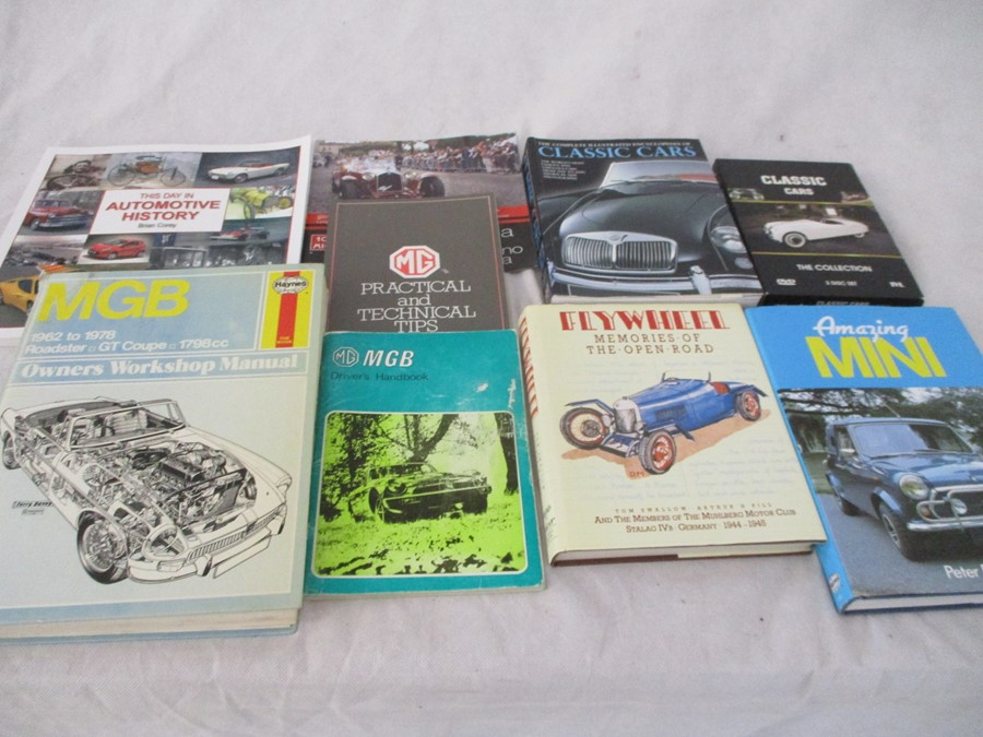 A small collection of car related books etc including MGB Haynes manual, Drivers handbook etc.