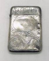 A hallmarked silver card case