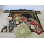 A collection of various linen and beadwork panels, patterns etc