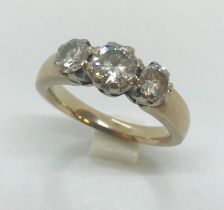 A substantial unmarked white gold ( tested as 18ct) diamond three stone ring of approximately 1ct