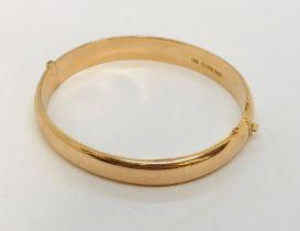 A 15ct gold hinged bracelet, 16.2g