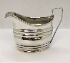 A Georgian hallmarked silver cream jug, weight 106.2g