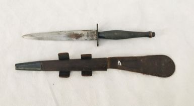A Fairbairn Sykes fighting knife in leather scabbard, the blade engraved Wilkinson Sword, London