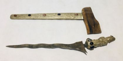 A 20th century Kris (possibly Balinese) with undulating double edged blade. The SCM grip formed as a