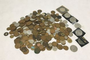 A collection of British and foreign coinage including a 1935 crown