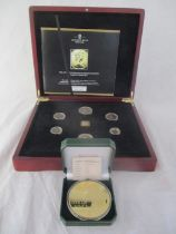 """A cased """"40th anniversary of decimalisation Majesty proof set"""" along with a """"Never give up"""""""