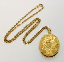 A 9ct gold locket on a 9ct gold chain- total weight 28.1g