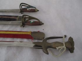 Three Indian swords, two in scabbards