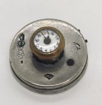 A continental silver button hole watch
