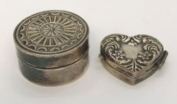 A small hallmarked silver heart shaped pill box along with one other ( marked 925)