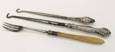 Two silver handled button hooks & a silver pickle fork