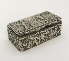 A small hallmarked silver pill box ( Chester 1900, George Nathan & Ridley Hayes) decorated with a