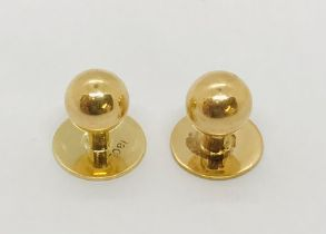 Two 18ct gold studs, weight 3.6g