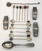 A collection of silver items including Sterling napkin rings, spoons etc.