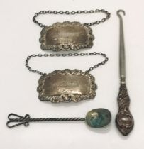 Two hallmarked silver bottle labels, button hook etc.