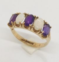 A 9ct gold ring with opals and amethysts