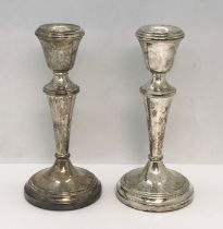 A pair of hallmarked silver candlesticks, 1972, height 14cm