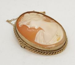 A cameo of a lady set in 9ct gold with safety chain