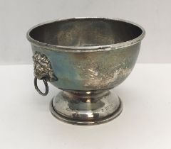 A hallmarked silver bowl with lions head handles, weight 99g