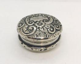 A hallmarked silver pill box