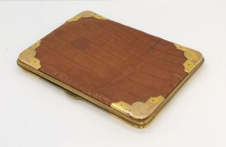 An antique crocodile skin wallet by Alexander Clark with 9ct gold corners for London 1907