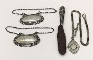 An unmarked silver Albert with fob along with two silver decanter labels and silver handled
