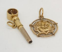 A Chinese gold pendant along with an unmarked gold watch key, total weight 5.8g