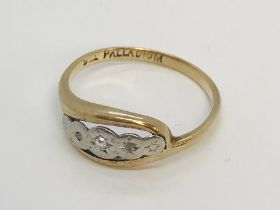 A 9ct gold ring with palladium set with diamond chips