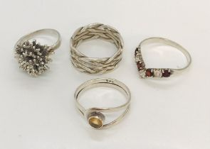 Four silver rings