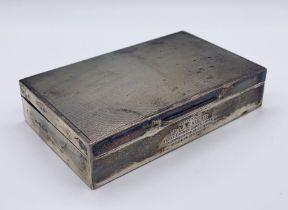 A hallmarked silver cigarette box