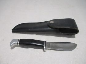 A Buck 103 (USA) sheath knife with single edged blade in matching leather case