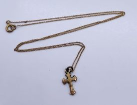 A 9ct gold cross on fine 9ct chain, total weight 1.2g