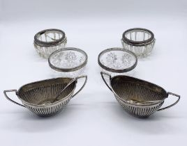 A pair of hallmarked boat shaped silver salts, four silver rimmed salts (1 A/F)and two silver salt