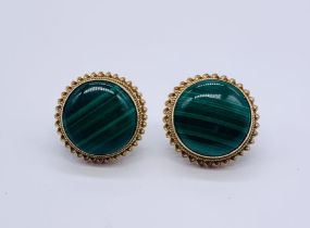 A pair of hallmarked 9ct gold earrings set with malachite