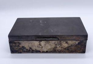 A hallmarked silver cigarette box, A/F