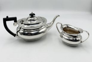 A hallmarked silver tea pot with matching sugar bowl ( Sheffield 1994) total weight 957.2g