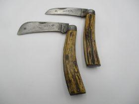 Two Saynor, Cooke & Ridal antler handled folding knives