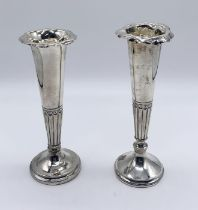 Two similar hallmarked silver trumpet vases