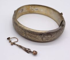 A hallmarked silver hinged bracelet along with a single 9ct gold earring (weight 0.6g)
