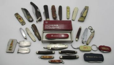 A collection of various penknives including Victorinox, Girl Guides, advertising etc.