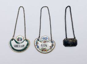 """A hallmarked silver decanter label """"Gin"""" along with two bone china labels, """"Gin"""" and """"Sherry"""""""