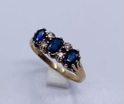 A diamond and sapphire ring set in 9ct gold