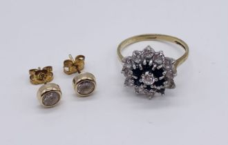 A 9 ct gold dress ring (1 stone missing) along with a pair of 9ct gold earrings - total weight 2.9g