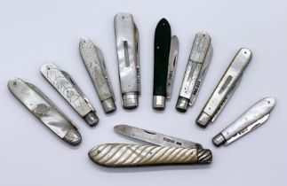 A collection of 9 folding fruit knives with hallmarked silver blades