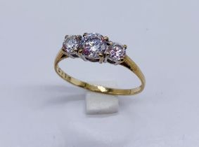 A 9ct gold trilogy dress ring