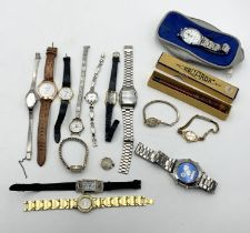 A collection of various watches and a vintage fountain pen